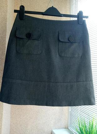 Актуальная юбка мини трапеция с накладными карманами