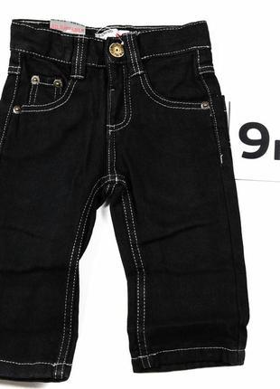 Черные джинсы с кармашками для мальчика 9 мес.