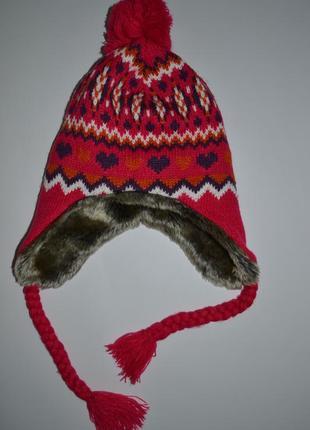 Теплая  вязаная шапка с мехом.