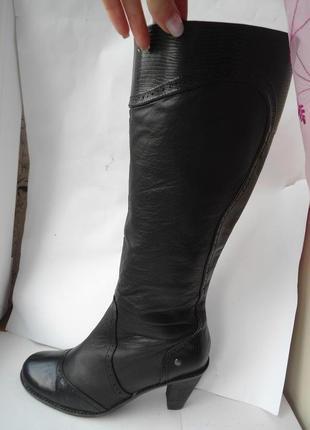 Демисезонные кожаные сапоги высокие. средний *высокий *каблук .нидерландский бренд