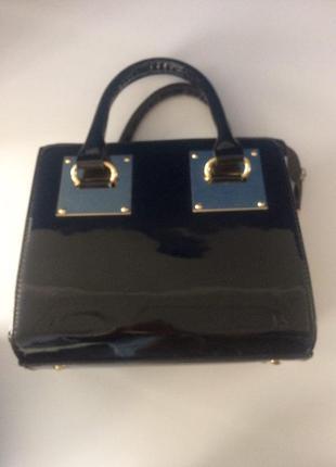 Лакированная мини-сумочка из натуральной кожи1