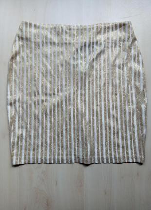 Юбка в бело - золотую вертикальную полоску с метализированной нитью