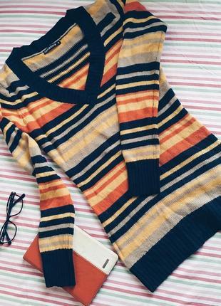 Полосатий пуловер