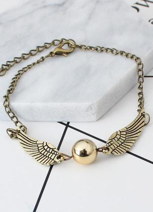 Браслет бронзового цвета с крыльями и бусиной