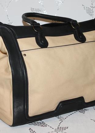 Дорожные большие кожаные сумки