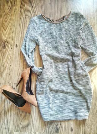 Тепленька сіра сукня із карманами
