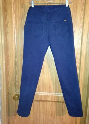 Брендовые брюки темно синего цвета