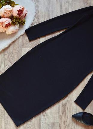 Трикотажное черное платье свободного кроя1 фото