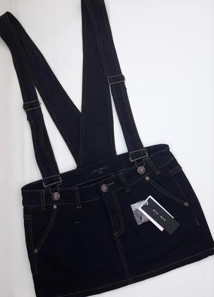 Крутой джинсовый стрейчевый комбенизон с юбкой на лямках с карманами бренда bik bok