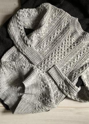 Серый свитер с косами atmosphere