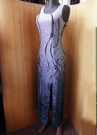 Серебристое длинное вечернее платье с резным подолом