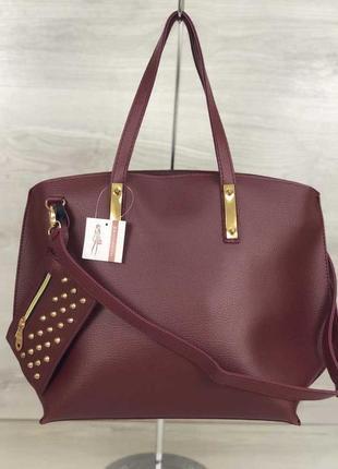 Бордовая оригинальная женская сумка с длинными ручками и ремешком
