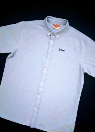 Брендовая рубашка с коротким рукавом.