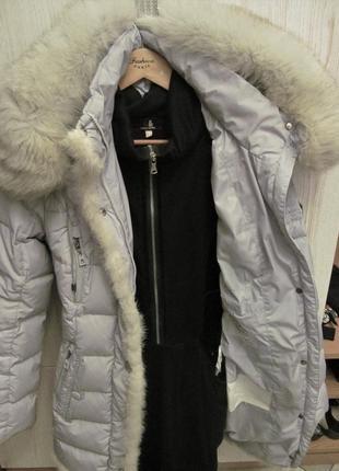 Зимова жіноча куртка пуховик  з капішоном.