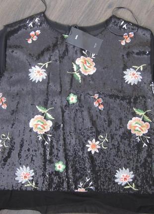 Нарядная блуза в паетках