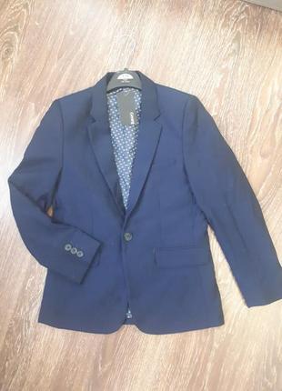 Новый темно синий пиджак на мальчика 9-10 лет
