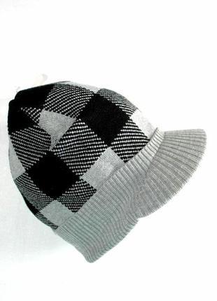 Модная трикотажная детская шапка с козырьком от takko fashion accessories, 8-15+ лет