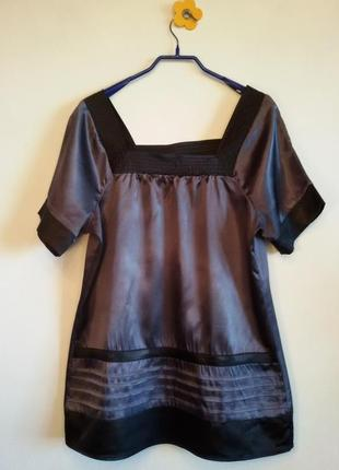 Просторная блуза отлично смотрится как с поясом, так и без него
