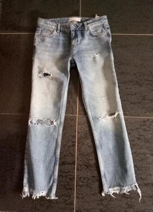 Джинсы с обрезанными штанинами