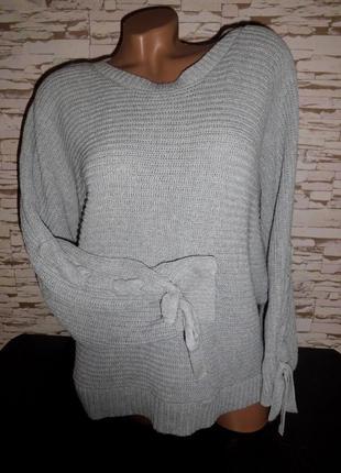 Стильная вязаная кофта,свитер tu,с  завязками на рукавах.