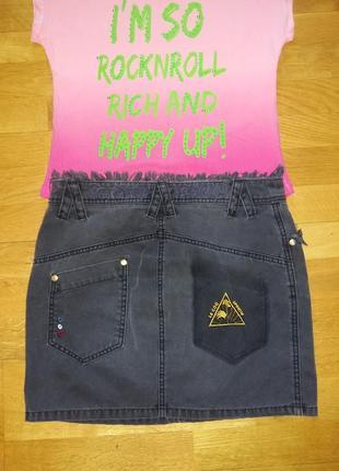Стильная джинсовая юбка трапеция французского бренда  le coq sportif с обстрепками