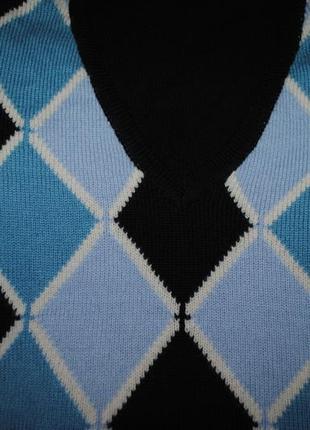 Фирменный .шикарный свитер-полувер.из шерсти мерино.