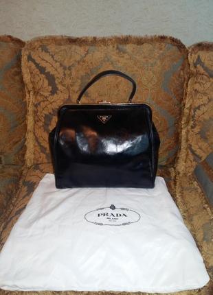 Черная сумка саквояж clasp bag prada оригинал