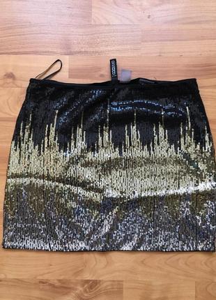 Мини юбка с пайетками.