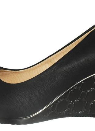 Женские туфли на танкетке