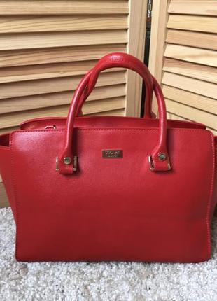 Крутая красная сумка итальянского бренда roberto uggari