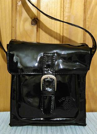 Стильная лаковая сумка-планшетка от jane shilton