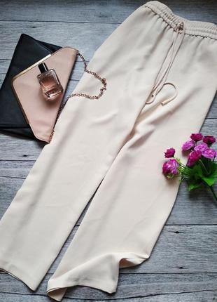 Широкие брюки, кюлоты молочного цвета от mango