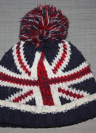 Крутая зимняя шапка  фир.mothercare для мальчика в отличном состоянии от 7 до 13лет