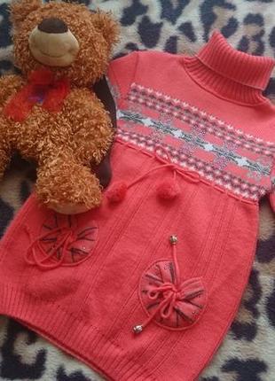 Красивая теплая вязаная туника-свитер кораллового цвета на девочку 6-7 лет
