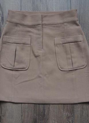 Мини-юбка с карманами спереди посадка на талии