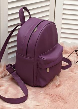 Небольшой удобный рюкзак фиолетового цвета, кожзам3 фото