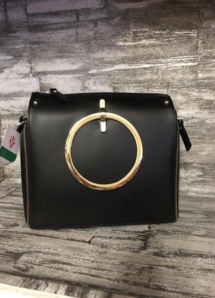 Модная кожаная сумка с ручками-кольцами. италия