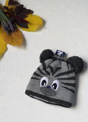 Тёплая шапка с ушками вязаная на флисе