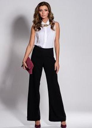 Черные широкие классические брюки, тренд сезона