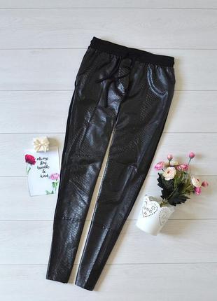Стильні комбіновані штани calzedonia.