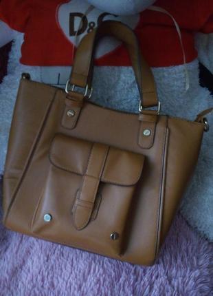 Стильна жіноча сумочка для справжньої леді