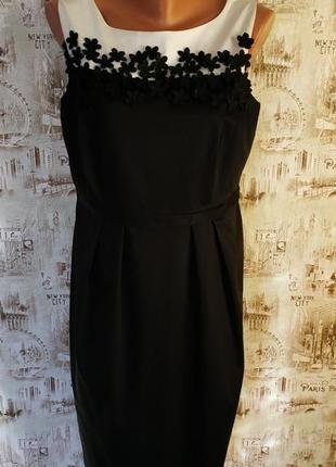 Очень красивое,нарядное и стильное платье. на бирке-14 р-р(48).