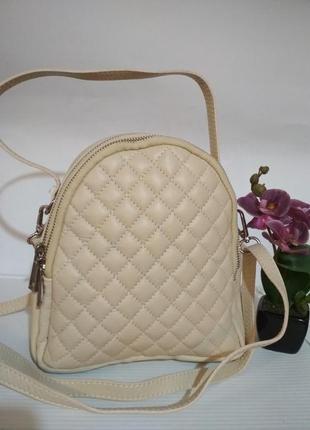 Удобная, вместительная кожаная сумочка