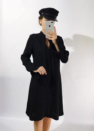 Стильное платье.своьодного кроя из плотной ткани1