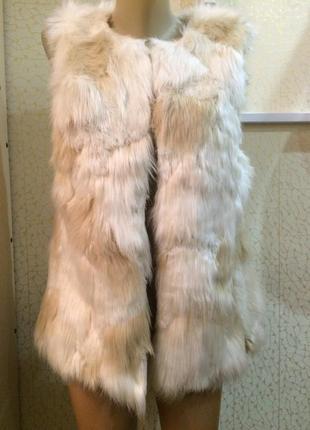 Теплая меховая жилетка