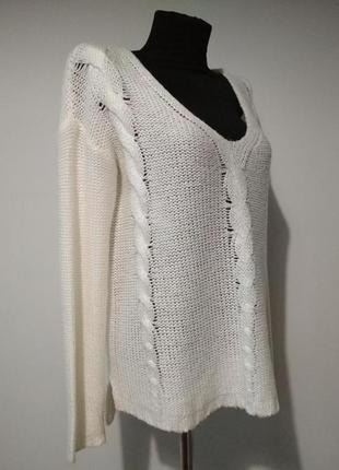 Асимметричный свитер с косами