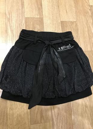 Блестящая чёрная юбка