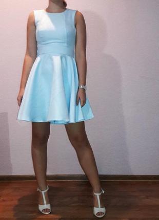 Нежно голубое платье с бантом