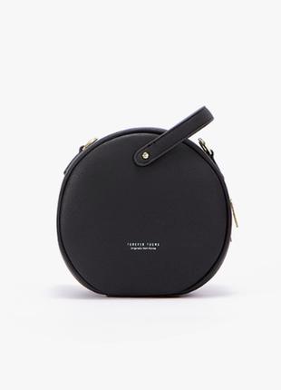 Очень стильная круглая сумка