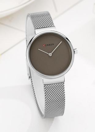 Стильные часы цвета металик
